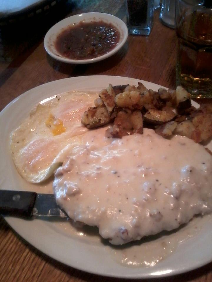 Chicken Fried Steak Topped With Sausage Gravy Two Eggs Home Fries Rudy S Little Hideaway